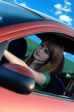 Girl in a car. Pretty smiling girl driving car royalty free stock images