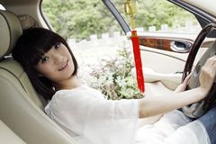 Girl in the car. Stock Images