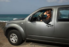 Girl and Car. Woman and her 4wd car at the beach Royalty Free Stock Photos