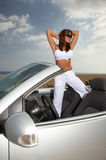 Girl and Car. Woman and her cabriolet car at beach Royalty Free Stock Photography