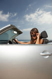 Girl and Car. Woman and her cabriolet car at beach Stock Images