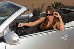 Girl and Car. Woman and her cabriolet car at beach Royalty Free Stock Photo