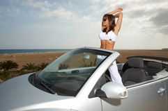Girl and Car. Woman and her cabriolet car at beach Royalty Free Stock Images