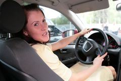 Girl in car Stock Images