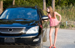Girl with car Royalty Free Stock Image