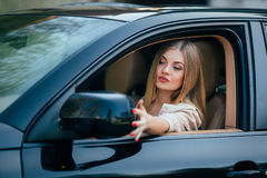 Girl in car arrange mirrow Stock Photo