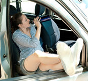 Girl in a car drinking water Royalty Free Stock Photo