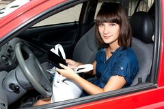 The girl in the car examination of documents befor Stock Photo