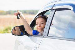 Girl in a car holding keys Stock Photo