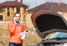 Girl with car   the hood open Stock Image