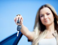 Girl with car key Stock Photo