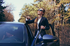 Girl with car key Stock Photography