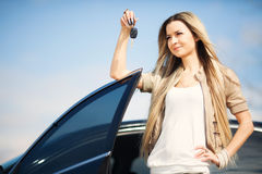 Girl with car key Royalty Free Stock Photos