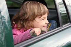 Girl in car looking throw window Stock Images