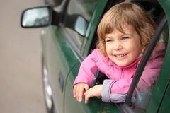 Girl in car looking throw window Stock Image