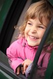 Girl in the car looking throw window Royalty Free Stock Images