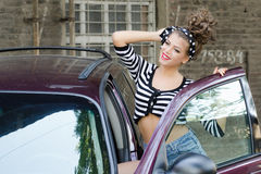 Girl with car. Model poses in front of the car Royalty Free Stock Photo