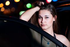 Girl by the car in the night Stock Photography