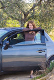 Girl with the car at the olive tree grove Stock Photo