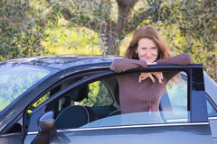 Girl with the car at the olive tree grove Stock Image