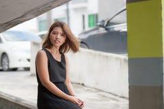 The girl at the car park. Bangkok, Thailand Royalty Free Stock Photography
