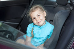 Girl in car safety seat Stock Photo