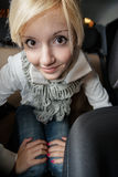 Girl in car salon Royalty Free Stock Image