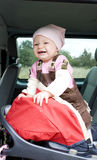 Girl in car seat Stock Photos