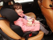 Girl in car seat Stock Images