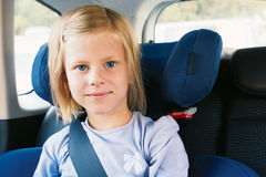 Girl in the car seat Stock Image