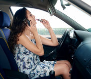girl in car talk on phone and makeup Royalty Free Stock Photography