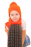 Girl with car tire Royalty Free Stock Photo