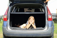 Girl in car trunk Royalty Free Stock Photos