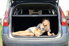 Girl in car trunk Royalty Free Stock Image