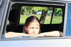 Girl in car window Royalty Free Stock Image