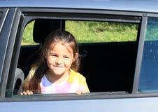 Girl in car window Stock Image