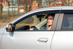 Girl and car. Woman sitting car looking out   window Royalty Free Stock Image