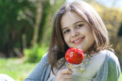Girl with caramel apple Royalty Free Stock Photography