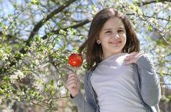 Girl with caramel apple Stock Photos