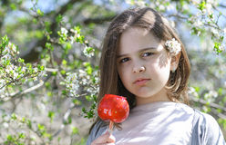 Girl with caramel apple Royalty Free Stock Image