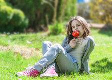 Girl with caramel apple Royalty Free Stock Photo