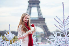 Girl with caramel apple on a Parisian Christmas market Stock Photography