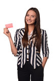 Girl with card. Young girl with red card Royalty Free Stock Photo