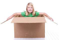 Girl in cardboard box Stock Images