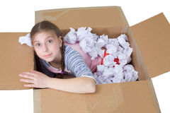 Girl in cardboard box Royalty Free Stock Images