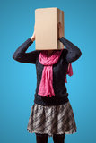 Girl with cardboard box head. Thinking girl with cardboard box head on violet background Royalty Free Stock Image