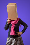 Girl with cardboard box head. Thinking girl with cardboard box head on violet background Stock Photo
