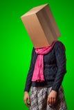 Girl with cardboard box head Stock Photo