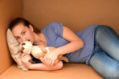 Girl in cardboard box Stock Photos