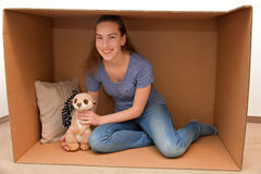Girl in cardboard box Royalty Free Stock Photography